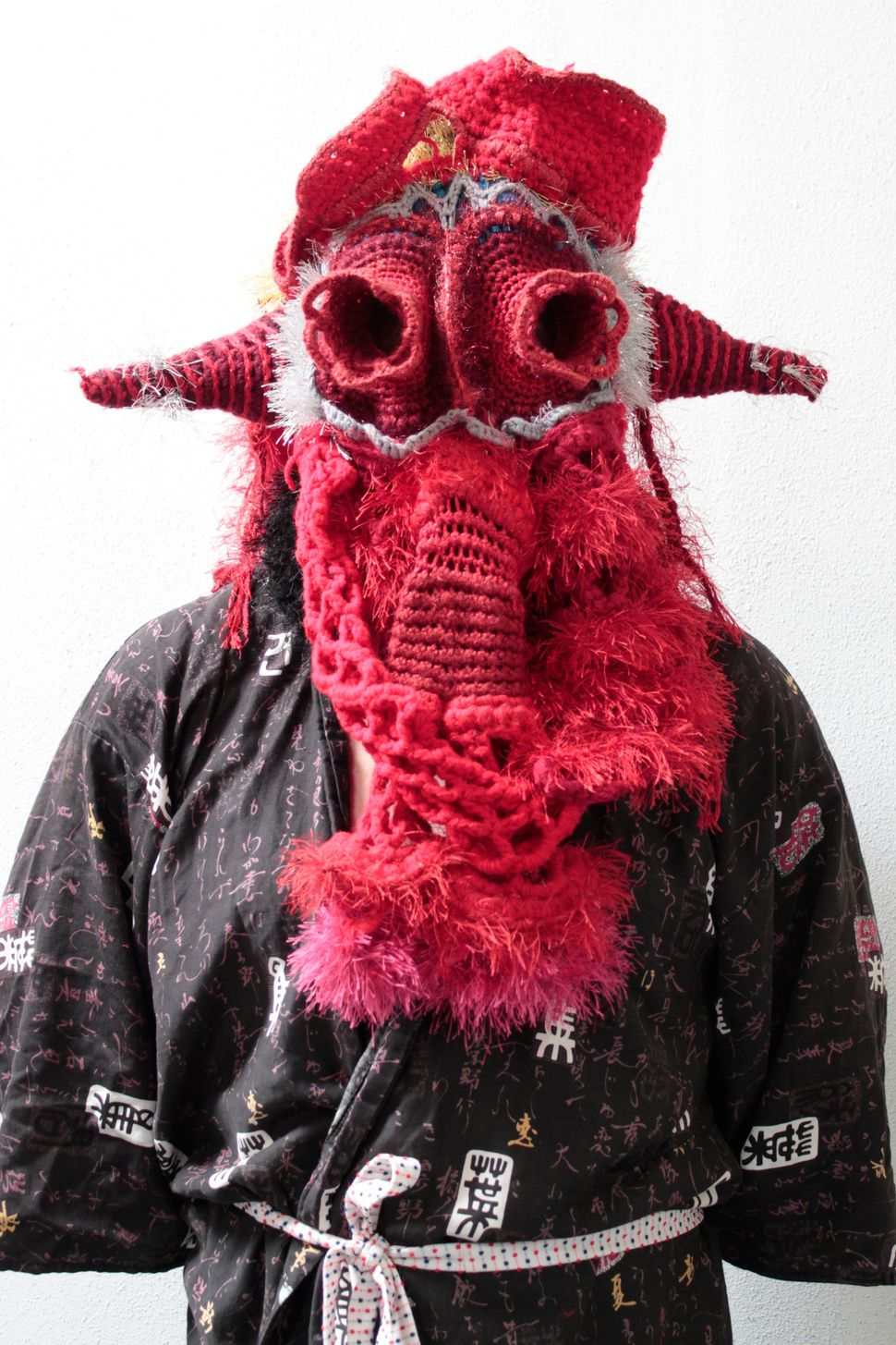 "Zac Monday, Bleedy Eyes, 2011, yarn, satin fabric, 72"" tall human figure"