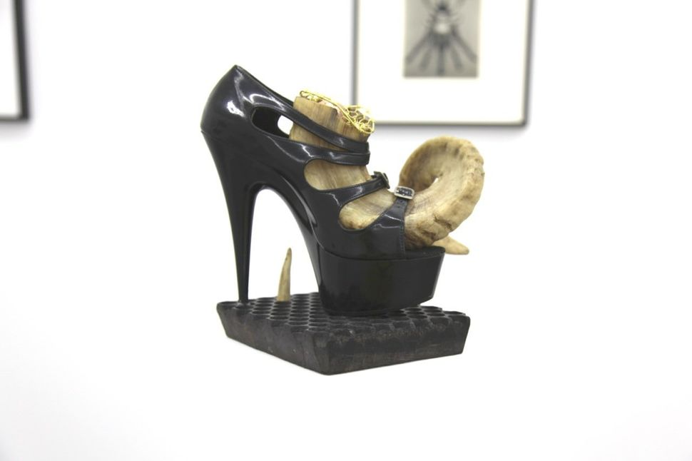 "BREYER P-ORRIDGE Shoe Horn #3, 2014 Ram horn, shoe worn by Genesis as ""Lady Sarah"" (her dominatrix persona), sting ray skin,"