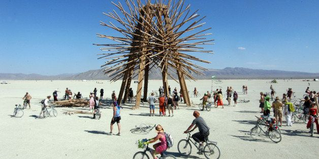 An art installation called Bamboo Spire, A 50-foot tall bamboo sculpture, stands on the playa Wednesday, Aug. 31, 2006, at Bu