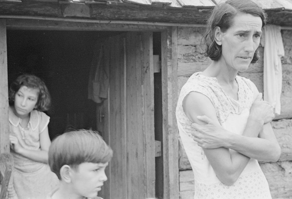 Ben Shahn, Boone County, Arkansas. The Family of a resettlement administration client in the doorway of their home. FSA, 1935