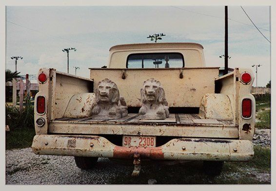 William Eggleston, Untitled ( Stone Lions in Truck Bed, Los Alamos Series), 1965 (print 1974), Dye-transfer print, 16 x 20 in