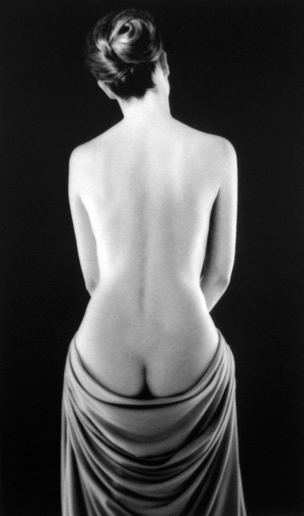 Ruth Bernhard, Draped Torso, 1962, Selenium-toned silver gelatin print, 12.75 x 8.25 in.  © Ruth Bernhard Estate. Courtesy Pe