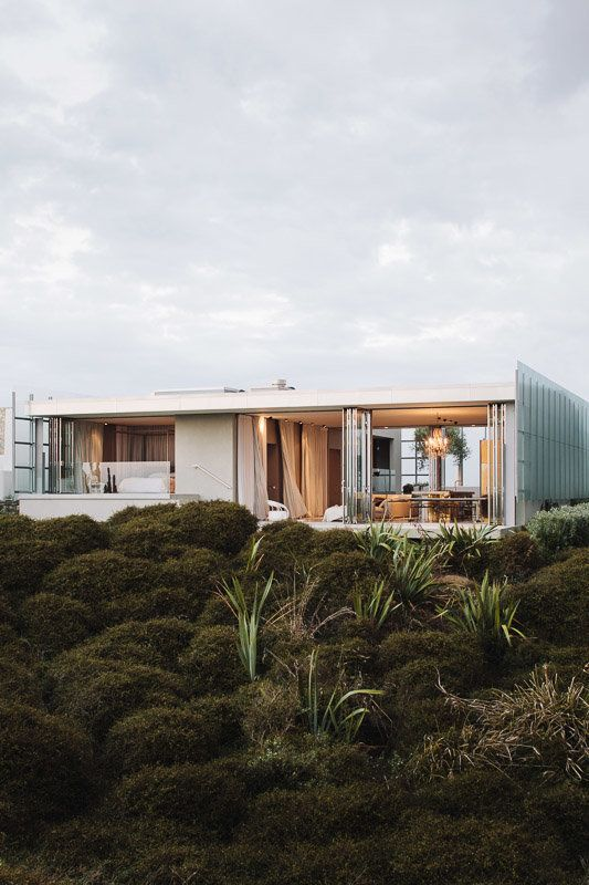 Dune House by Fearon Hay. This house is located on the east coast of New Zealand's North Island, nearly an hour's drive north