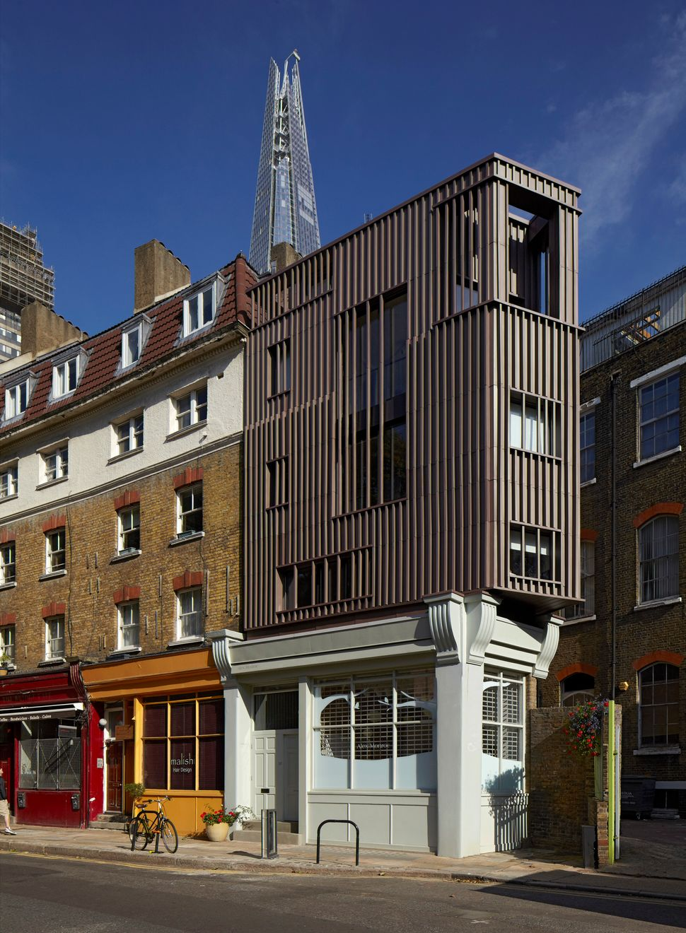 "<strong>Alex Monroe Studio, Snowfields, designed by DSDHA.</strong> ""The new building operates as a bespoke 'bookend' to the"