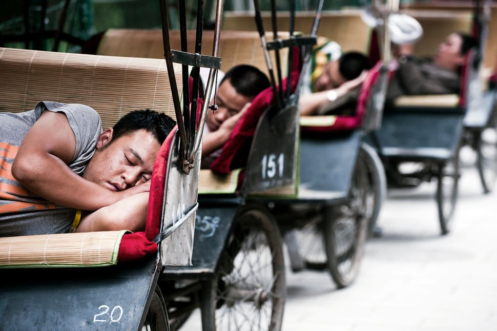 Áron Süveg	 Hungarian	 Nappers	Bicycle rickshaw drivers taking some break and nap in a silent street in the heart of Beijing.