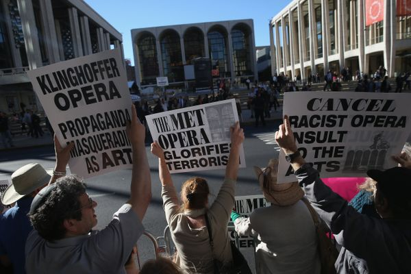 NEW YORK, NY - SEPTEMBER 22:  Protesters demonstrate as people arrive for the opening night of the Metropolitan Opera season