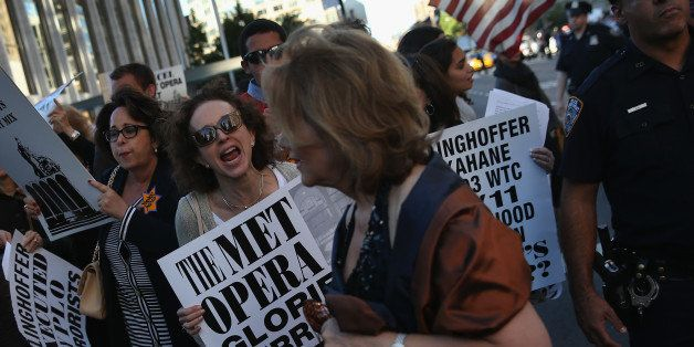 NEW YORK, NY - SEPTEMBER 22:  Protesters yell at people attending the opening night of the Metropolitan Opera season at Linco