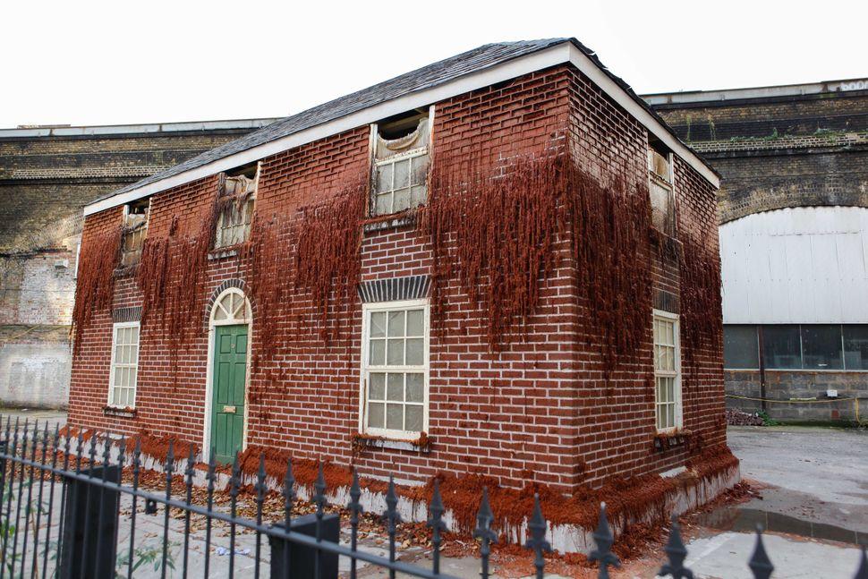 "<a href=""http://mergefestival.co.uk/"">Melting House</a> by <a href=""http://www.alexchinneck.com/"">Alex Chinneck</a>"