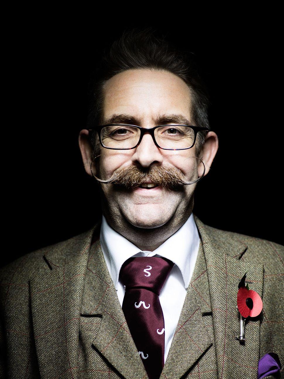Handlebar Club member Allan Robinson, sporting a classic handlebar moustache.