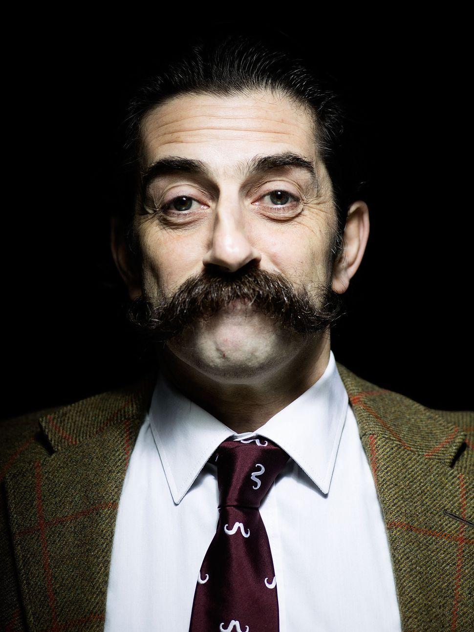 "Handlebar Club member John ""The Dentist,"" sporting an unwaxed classic handlebar moustache."