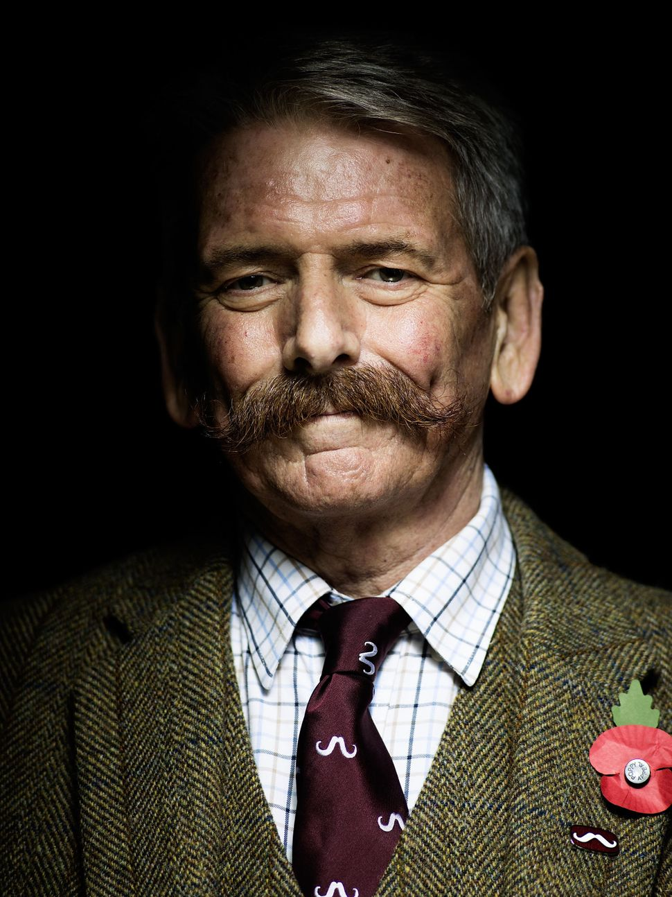 Handlebar Club member John Satchell, sporting a classic handlebar moustache.