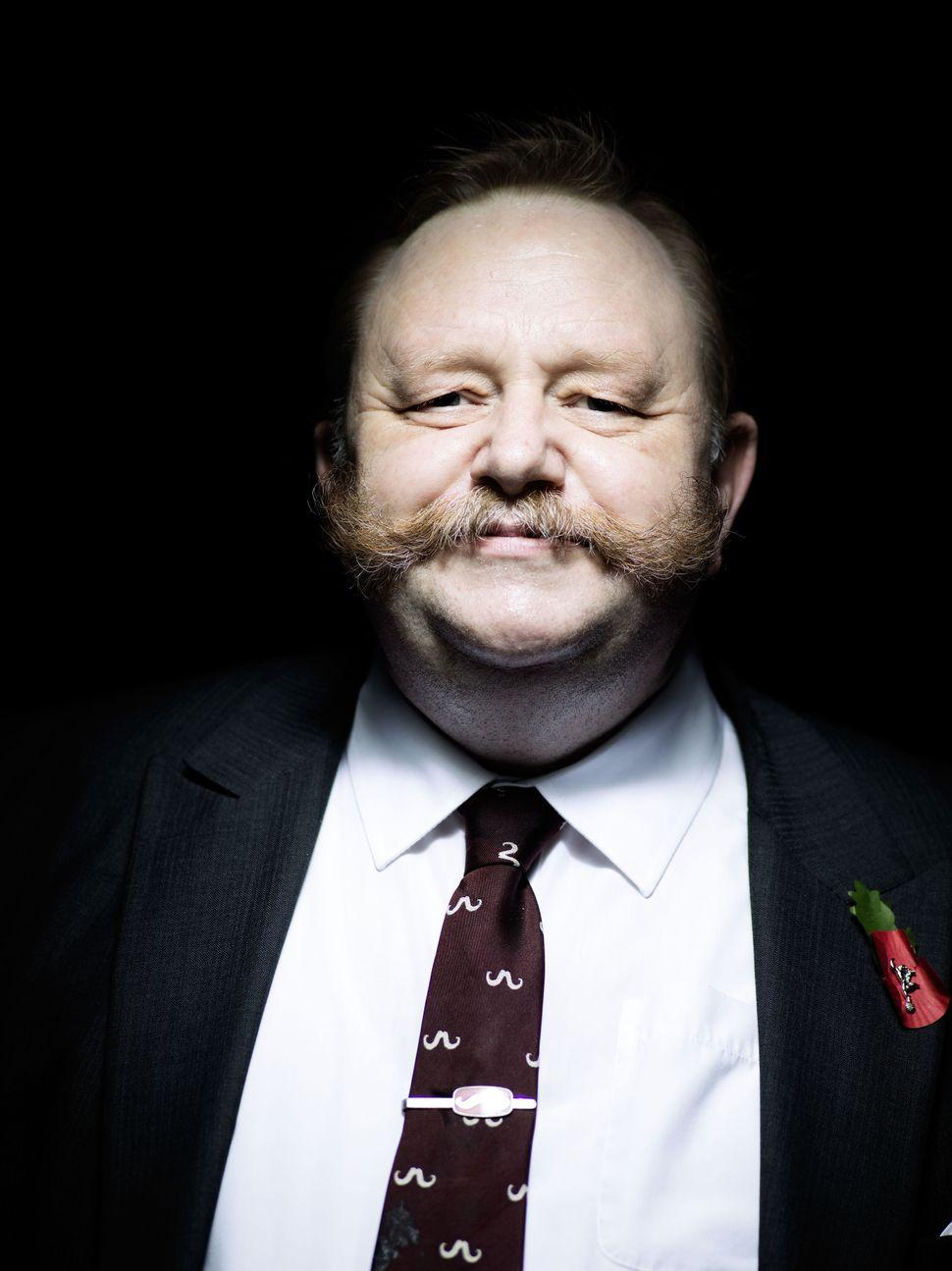 "Handlebar Club member Major (retired) David Tomlinson TD, sporting a ""natural partial beard."""
