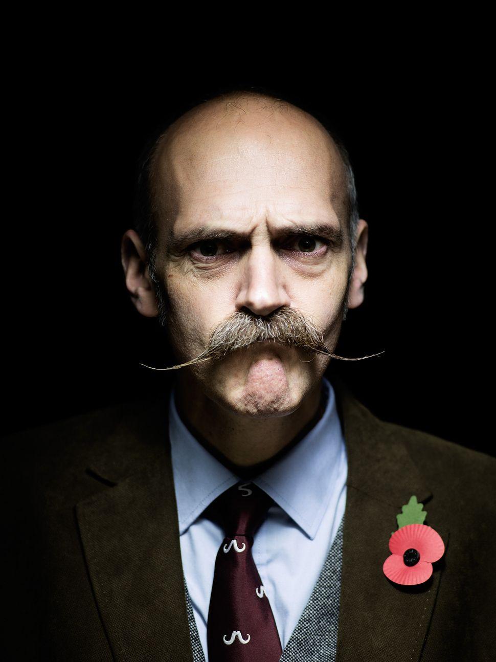 "Handlebar Club member Glen Turner, sporting an ""English, but getting close to a Dali moustache."""