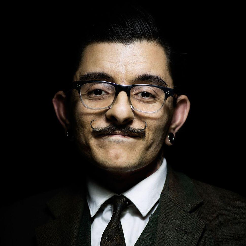Handlebar Club member Tariq Khan, sporting an unwaxed classic handlebar moustache.