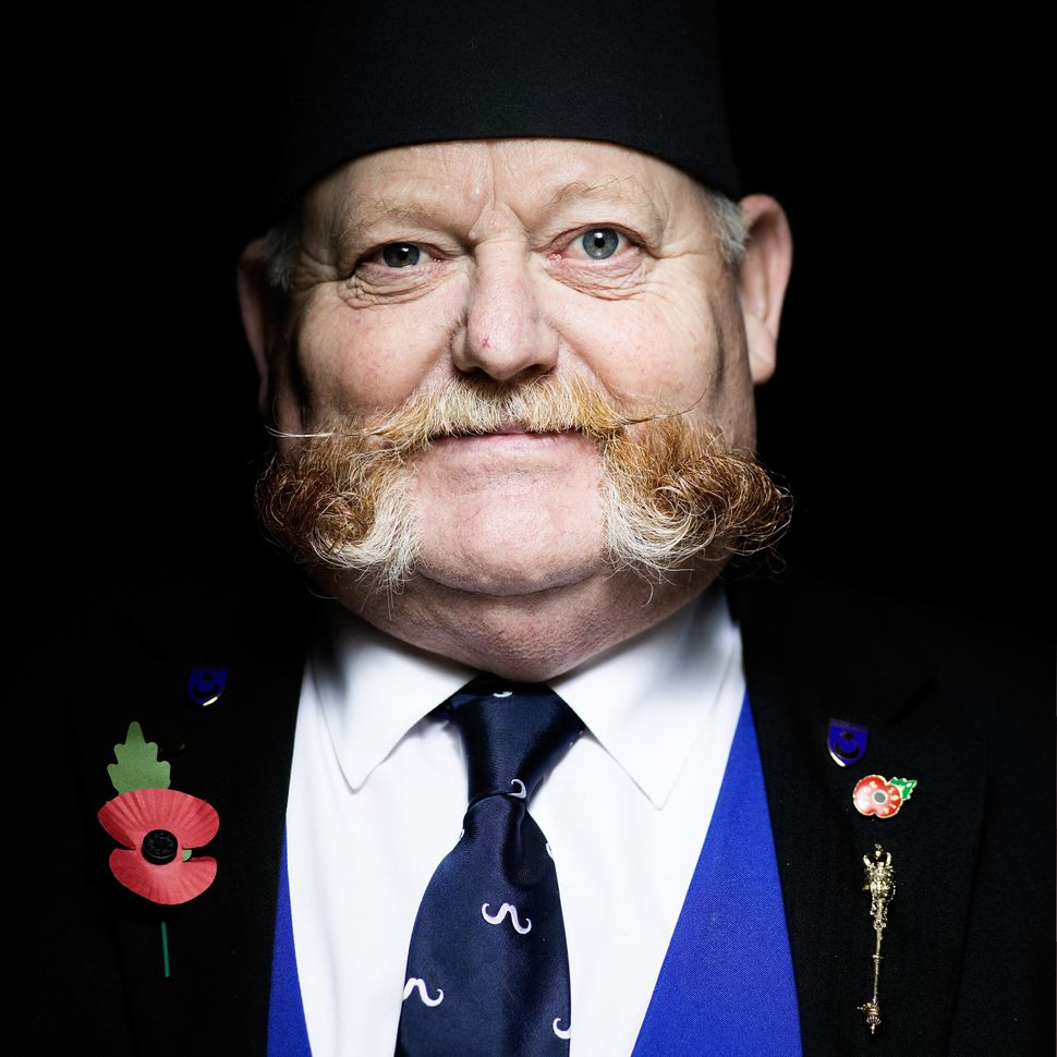 Handlebar Club member and British Freestyle Champion Alan Spencer, sporting a mutton chop moustache.