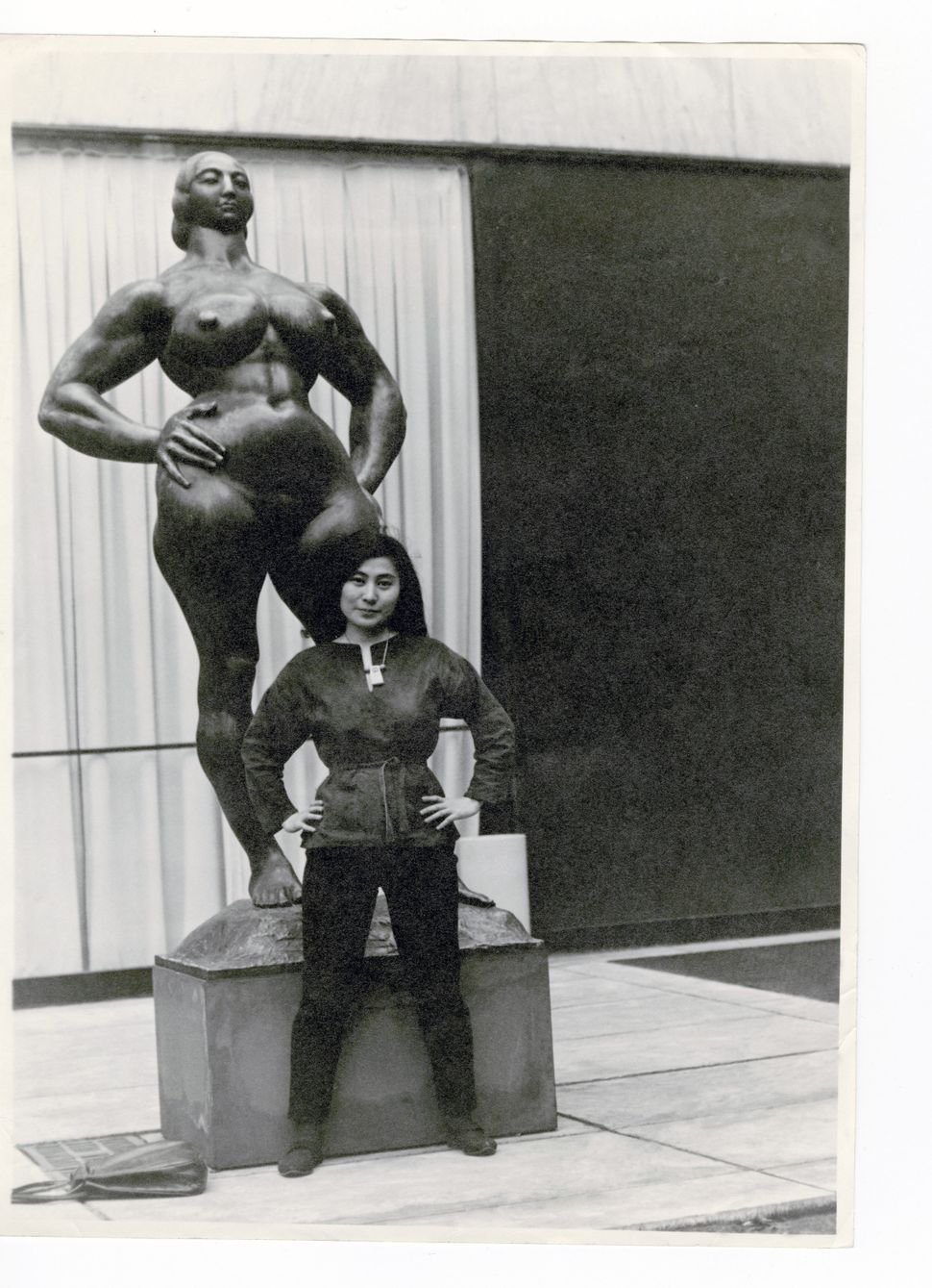 Yoko Ono with Standing Woman (1932) by Gaston Lachaise, The Museum of Modern Art Sculpture Garden, New York. c. 1960–61. Phot