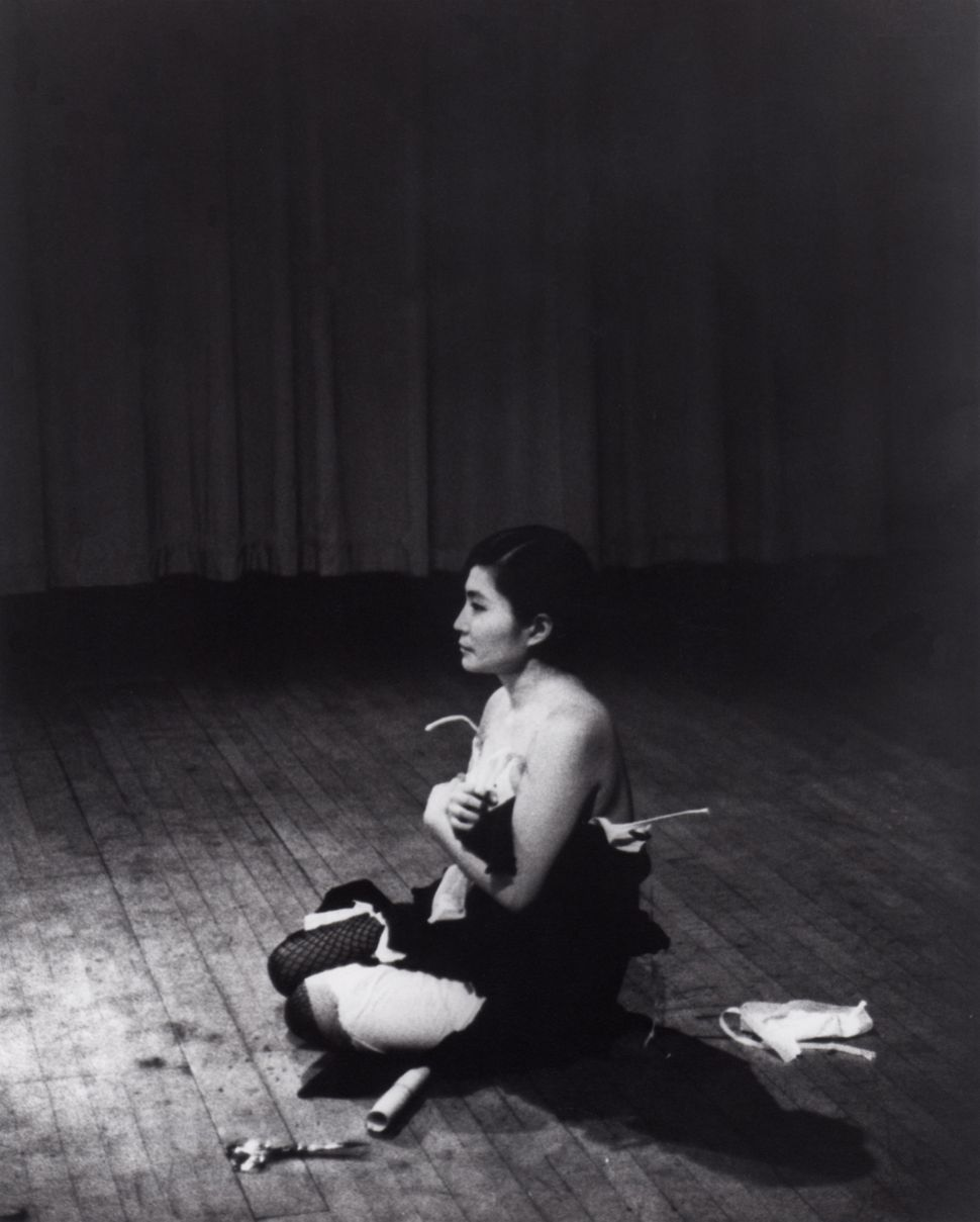 Cut Piece (1964) performed by Yoko Ono in New Works of Yoko Ono, Carnegie Recital Hall, New York, March 21, 1965. Photograph
