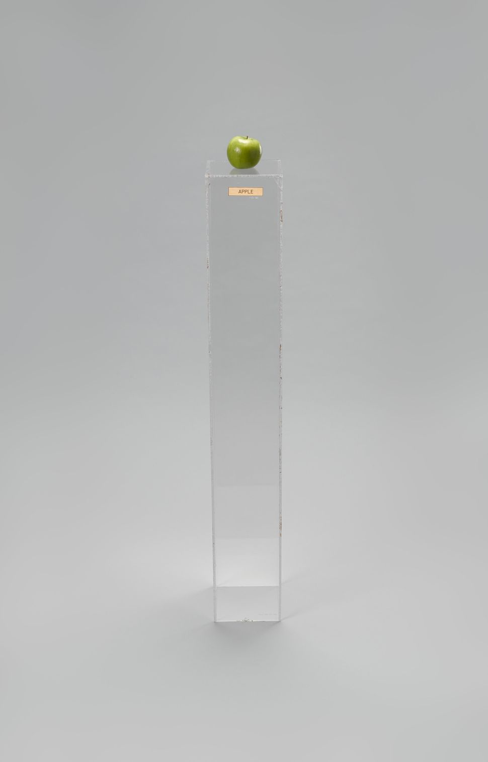 Yoko Ono (Japanese, born 1933) Apple. 1966. Plexiglas pedestal, brass plaque, apple, 45 × 6 11/16 × 6 15/16″ (114.3 × 17 × 17