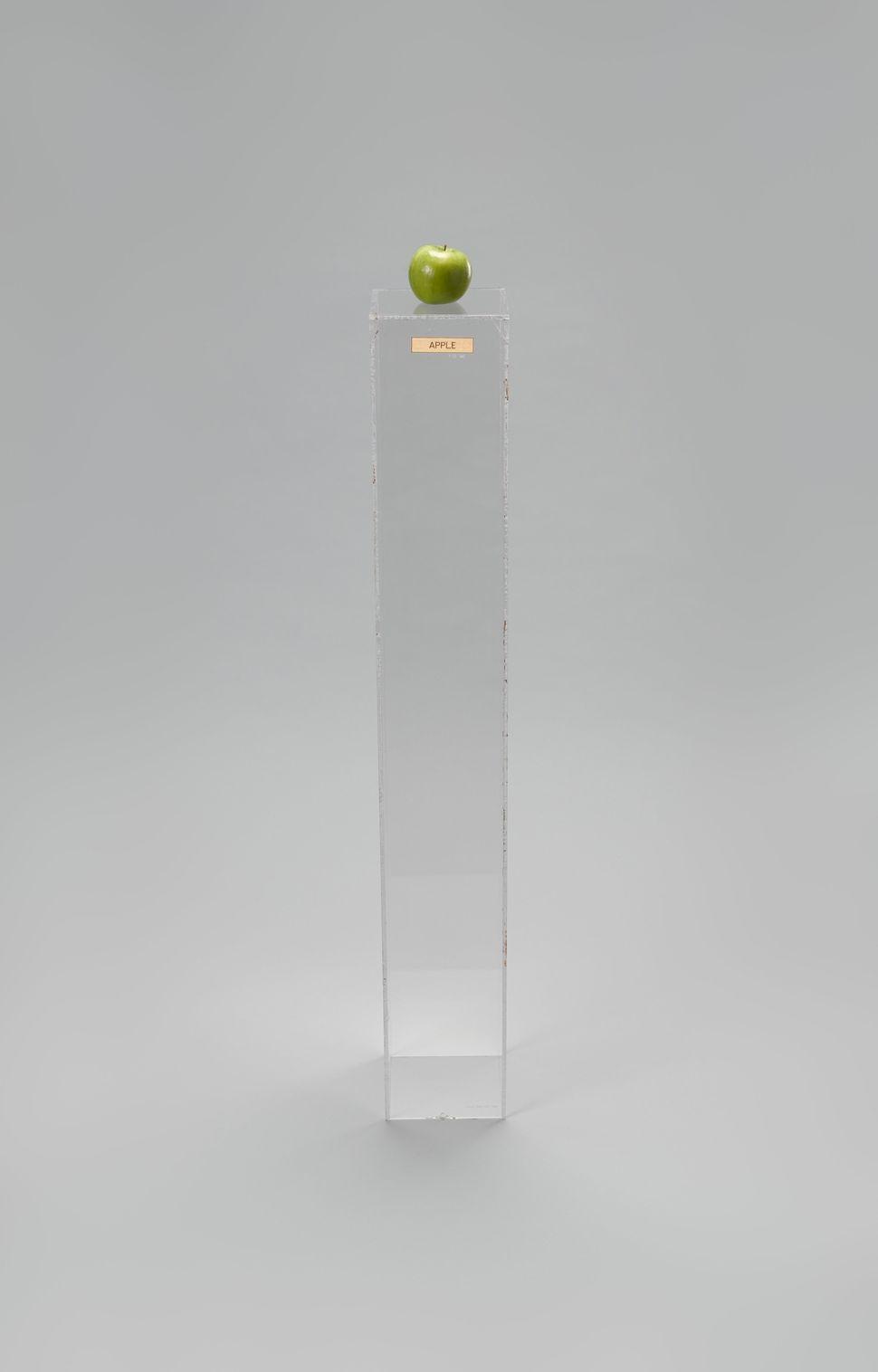 Yoko Ono (Japanese, born 1933) Apple. 1966. Plexiglas pedestal, brass plaque, apple, 45 × 6 11/16 × 6 15/16″ (114.3 × 17 × 17