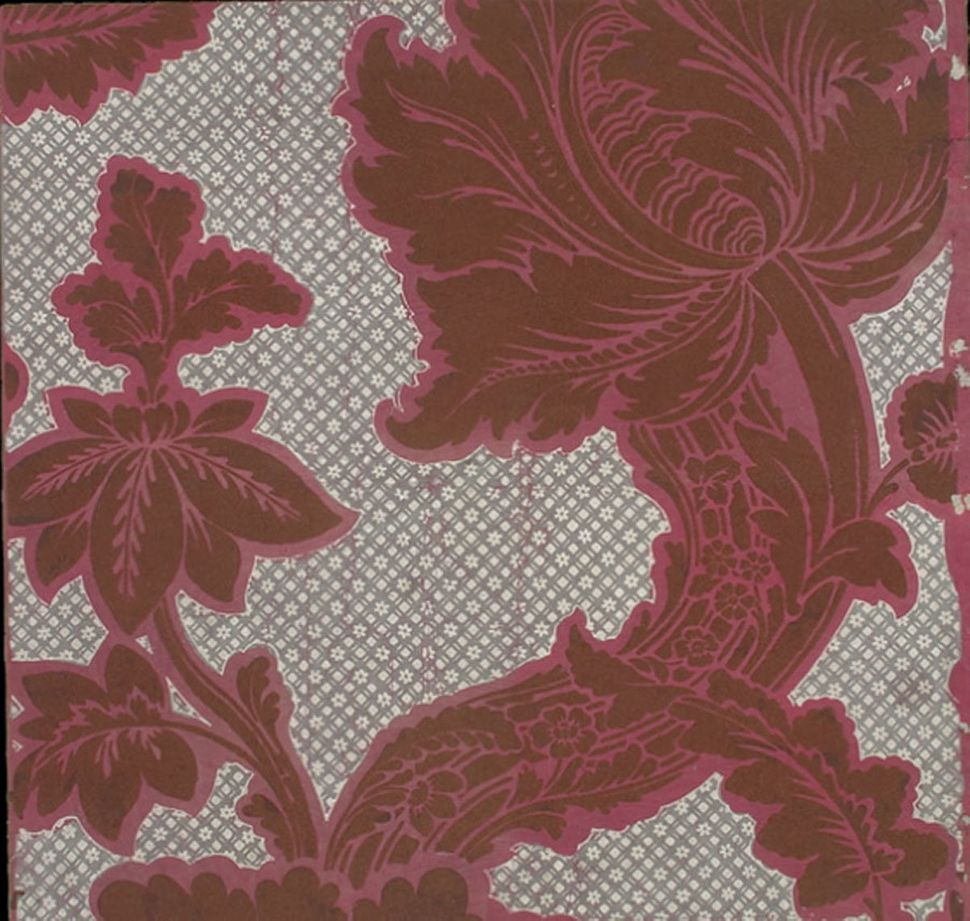 Cut sample of flocked paper. Crimson ground, with diapered patterning in gray and white, floral design in crimson flock. Engl