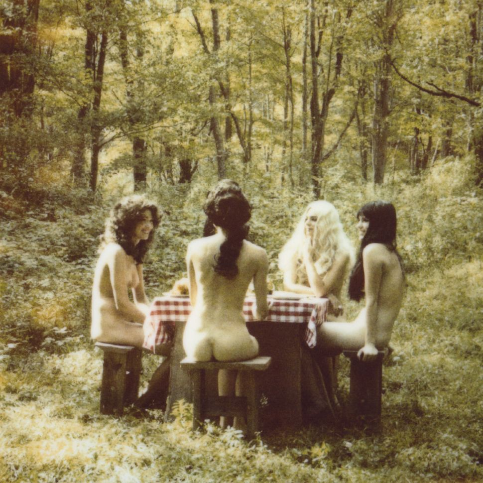 Rothen's dreamy photos feel like stills from a classic retro film that doesn't exist. Women dolled up in garishly fake wigs a