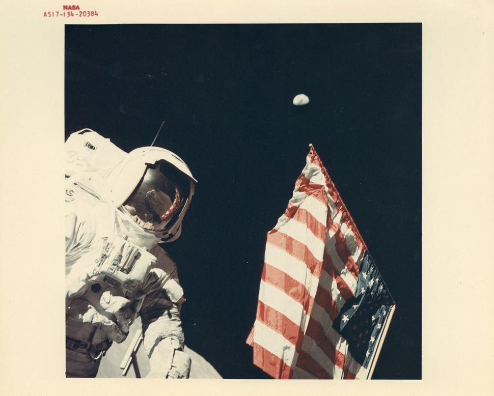 Eugene Cernan, Harrison Schmitt with the Earth above the US flag, EVA 1, Apollo 17, December 1972
