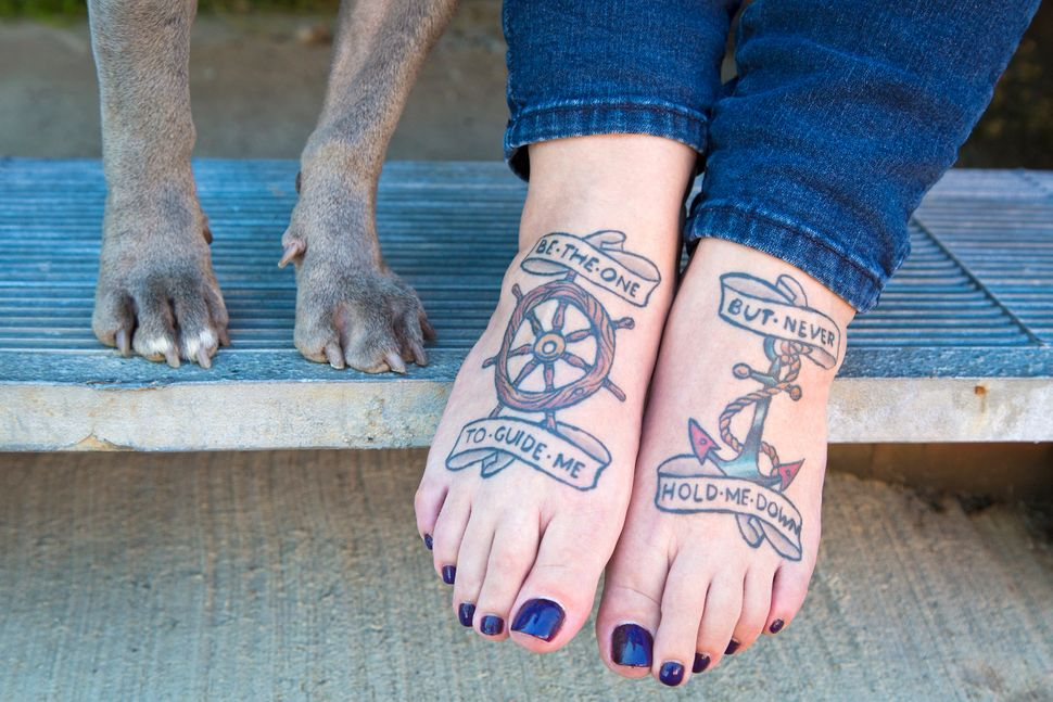 "See more from the Tattoos & Rescues photo series on <a href=""http://www.brimanphoto.com/"">Brian Batista's website</a>"