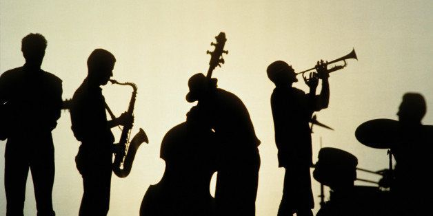 Silhouette of five players in jazz band, white background