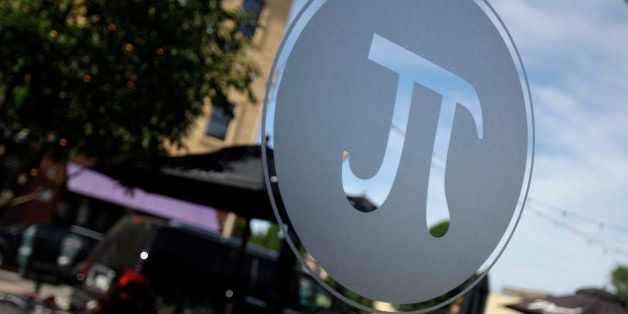 The symbol for Pi is seen on a window at Pi pizza Thursday, June 4, 2009, in St. Louis. (AP Photo/Jeff Roberson)