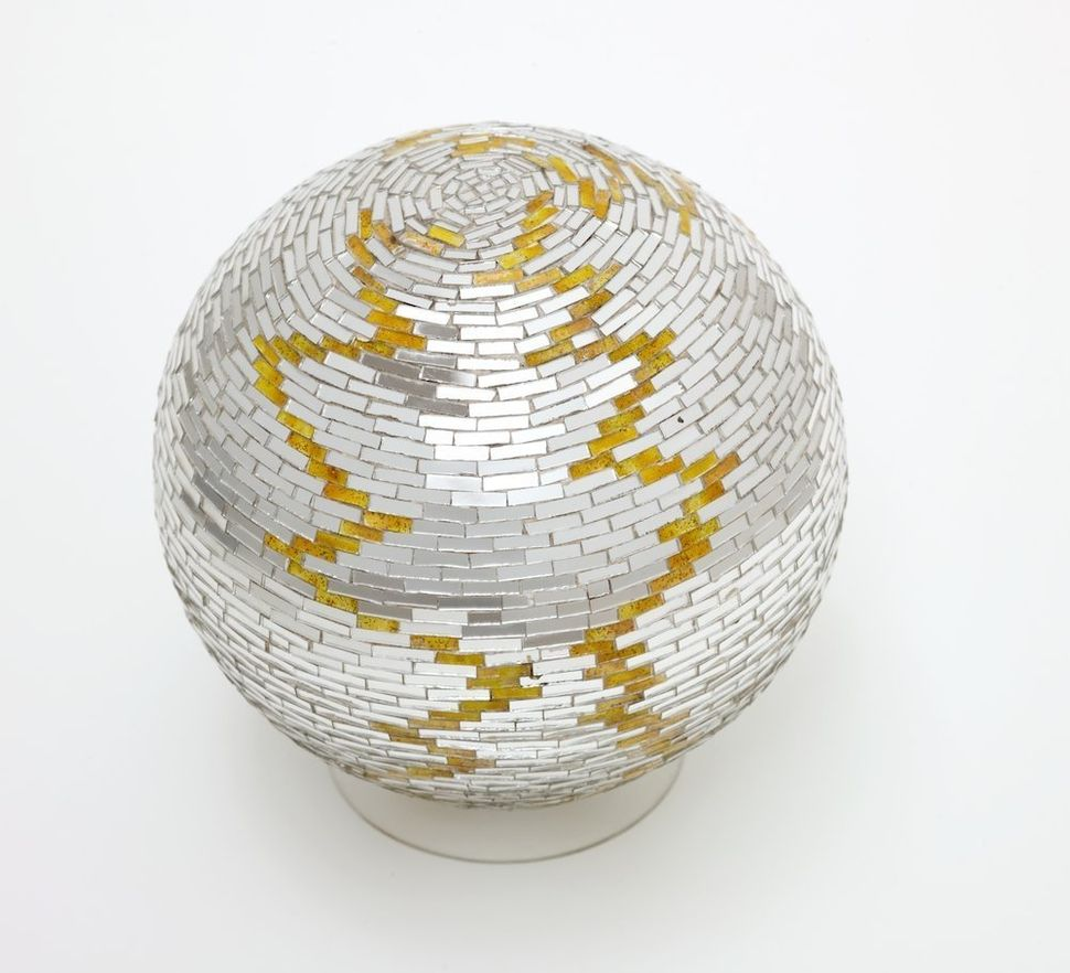 Monir Shahroudy Farmanfarmaian, Mirror Ball, c. 1974, Mirror on plaster ball, 19 x 19 x 19 cm, Collection of Nima Isham, Clyd