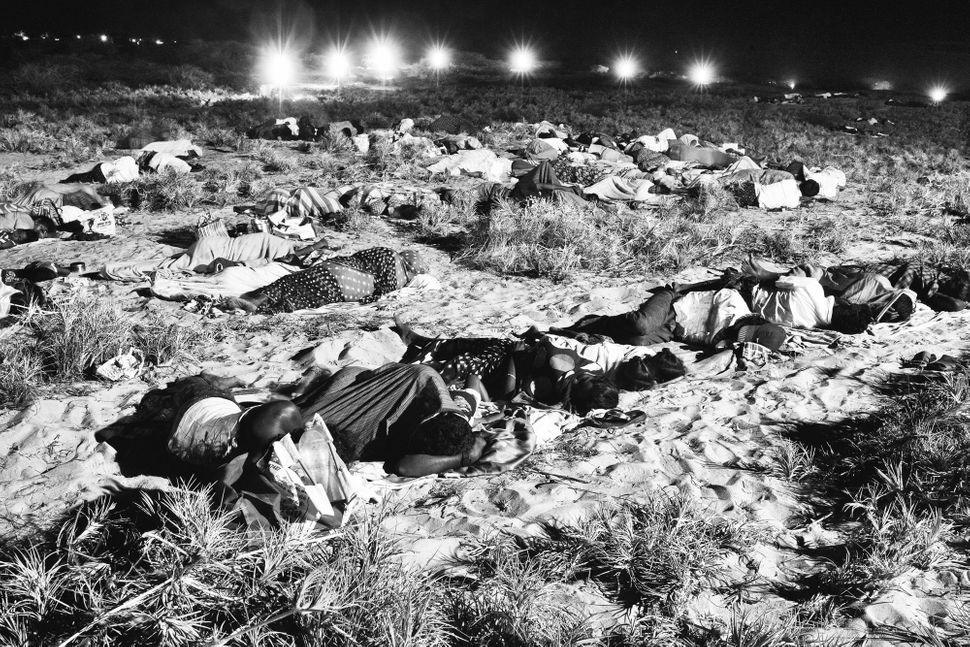 Idinthakarai villagers and their children sleep on the seashore near Koodankulam Nuclear Power Plant, protesting the commissi