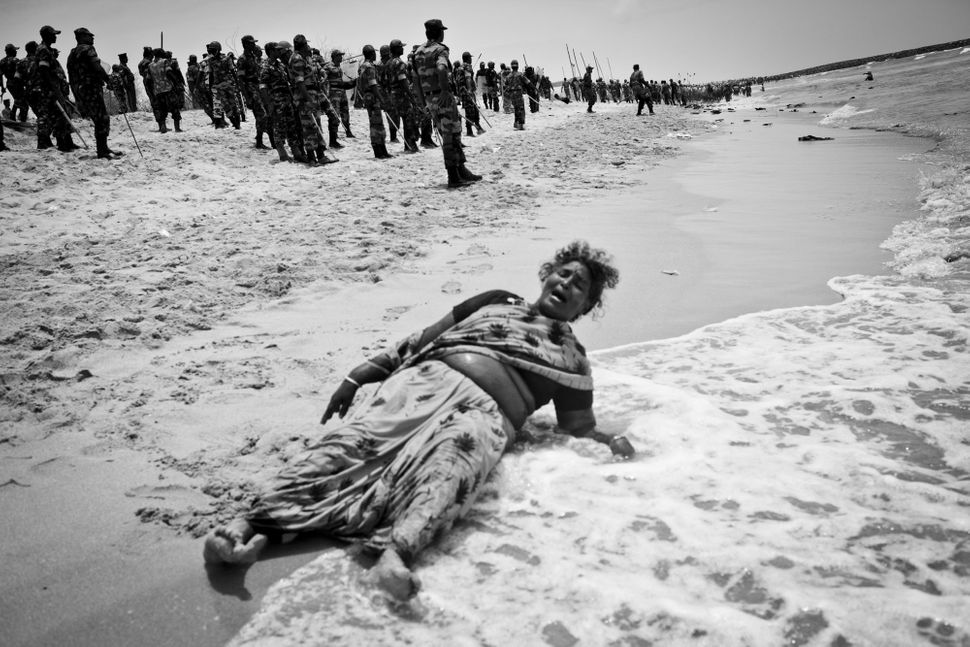 Xavieramma, a resident of Idinthakarai, cries out for help after being chased into the sea with no place to run. She is later