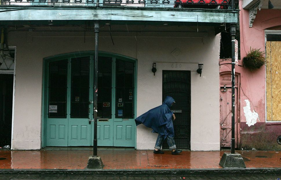 A man walks through the French Quarter in New Orleans, Louisiana, on Sept. 23, 2005. Rain and wind had started to hit New Orl