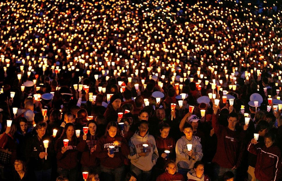 Thousands of people attend a candlelight vigil on the campus of Virginia Tech on April 17, 2007, in Blacksburg, Virginia. Eng