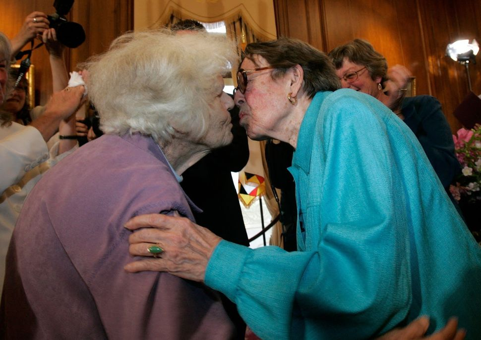 Same-sex couple Del Martin (L) and Phyllis Lyon (R) kiss after they were married by San Francisco mayor Gavin Newsom in a pri