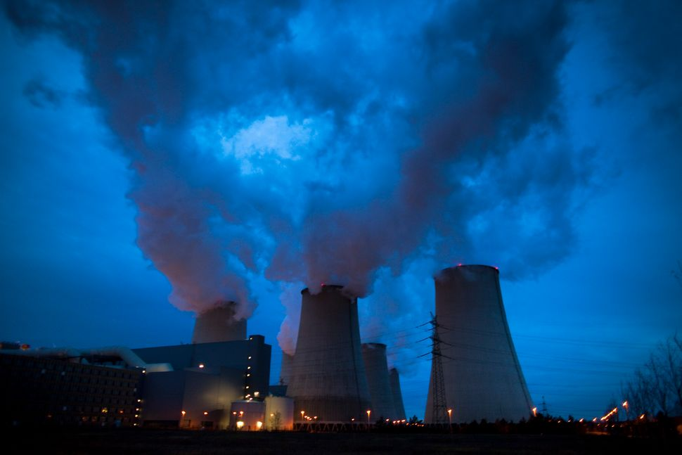 Exhaust plumes from cooling towers at the Jaenschwalde lignite coal-fired power station on Nov. 24, 2009, in Janschwalde, Ger