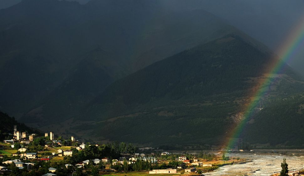 A rainbow is seen over the mountains in the Upper Svanti region not far from the town of Mestia, Georgia on Sept. 8, 2010. Hi