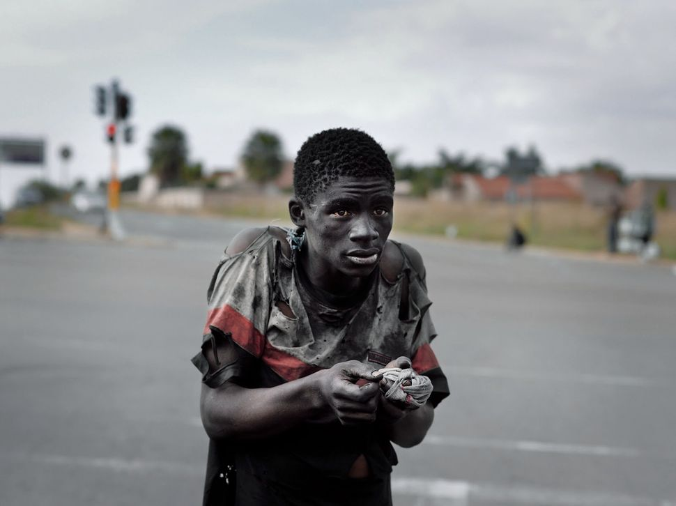 Photographer Pieter Hugo captures the fractured state of contemporary South Africa in 2011, still wounded with scars of colon