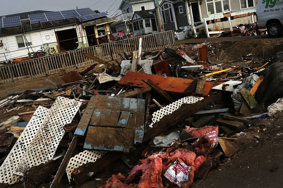 Debris is viewed outside of a home on Dec. 4, 2012, in the Breezy Point neighborhood of the Queens borough of New York City.