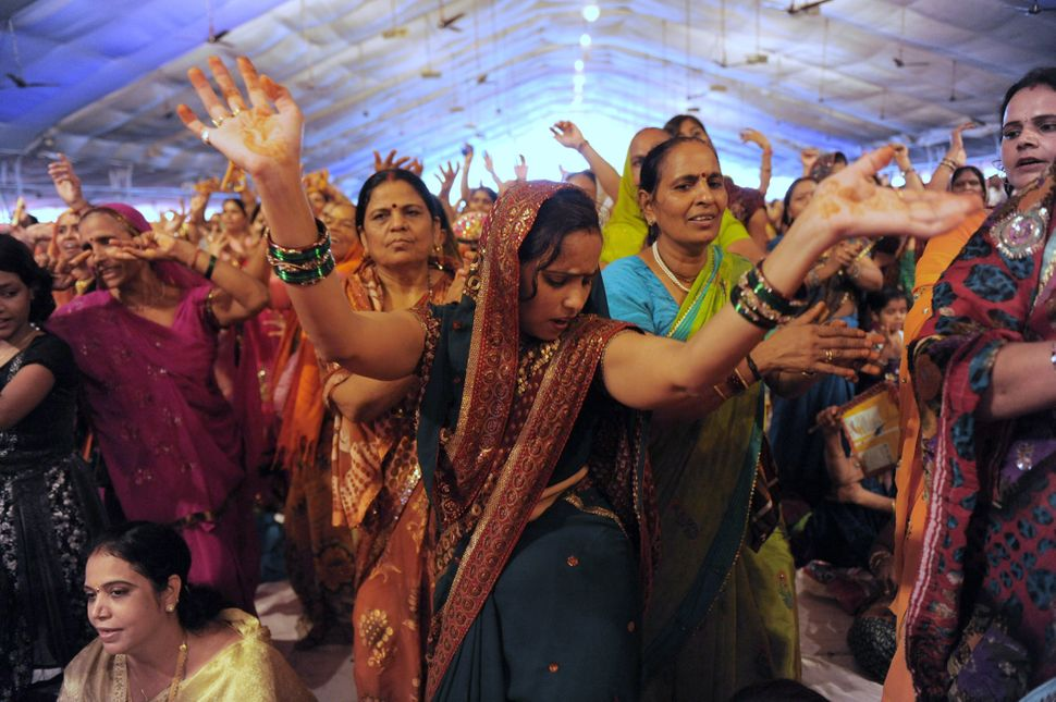 Supporters dance during a religious function organized by Indian yoga Guru Baba Ramdev (unseen) in Ahmedabad in India on Aug.