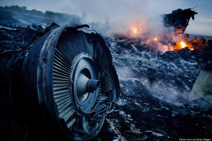 Debris from Malaysia Airlines Flight 17 is shown smoldering in a field on July 17, 2014, in Grabovo, Ukraine, near the Russia