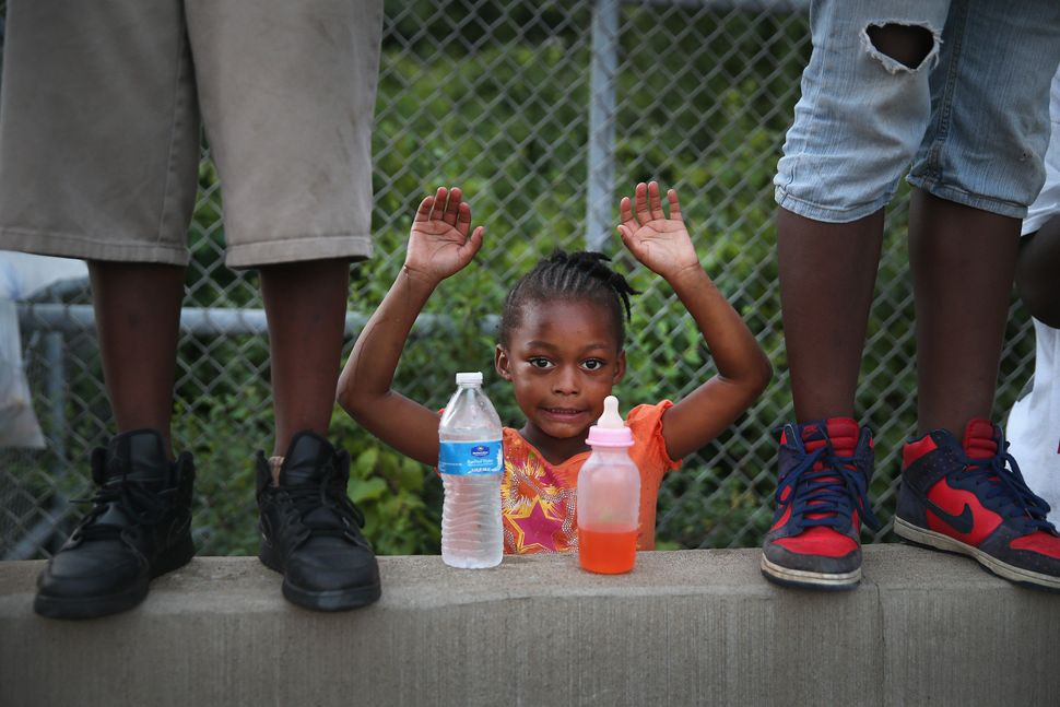 Gabrielle Walker, 5, protests the killing of teenager Michael Brown on Aug. 17, 2014, in Ferguson, Missouri. Despite the Brow