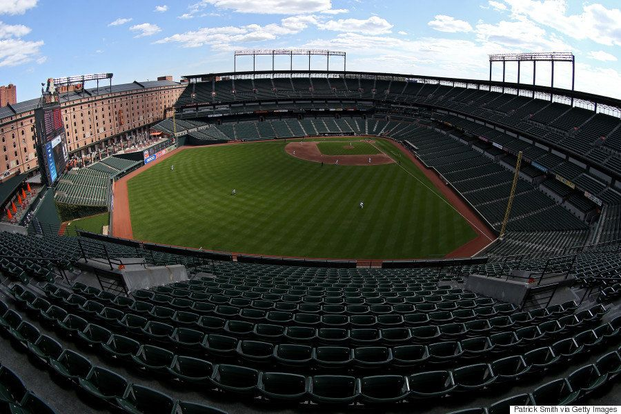 The Baltimore Orioles and Chicago White Sox stand for the national anthem at an empty Oriole Park at Camden Yards on April 29
