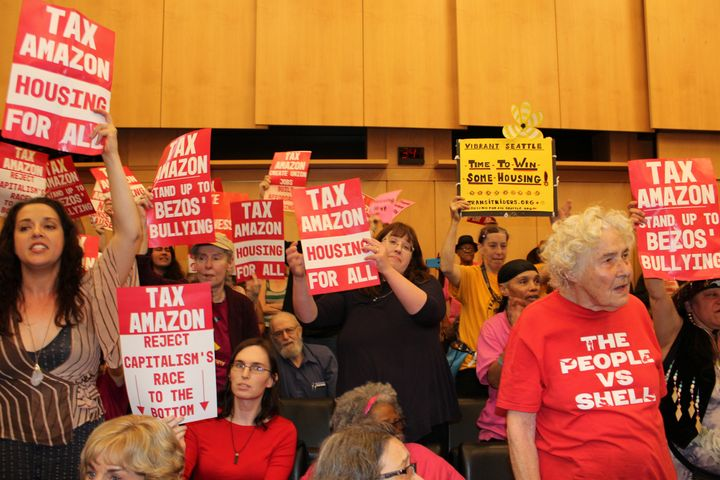 A Seattle City Council debate over the Employee Head Tax, a fee for large corporations that was repealed under threat of a ba