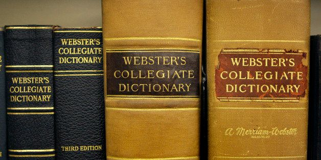 Archive copies of the Collegiate Dictionary rest on a bookshelf at the headquarters of the Merriam-Webster dictionary publish