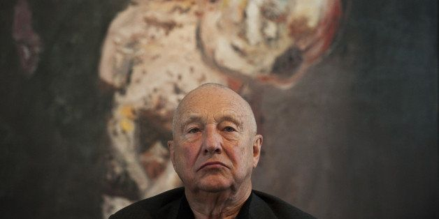German painter Georg Baselitz addresses a press conference, sitting in front of his painting 'Grosse Nacht im Eimer' (Big Nig