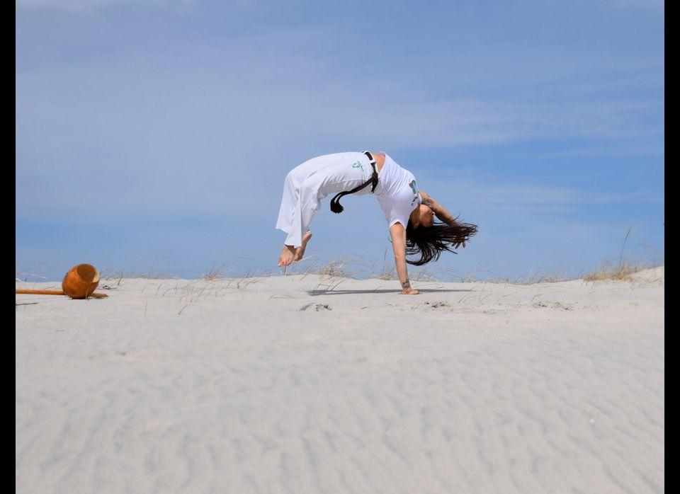 Professora Pimentinha demonstrating a Capoeira Floreio called a Macaco. (Photo by Sabrina Sampaio)
