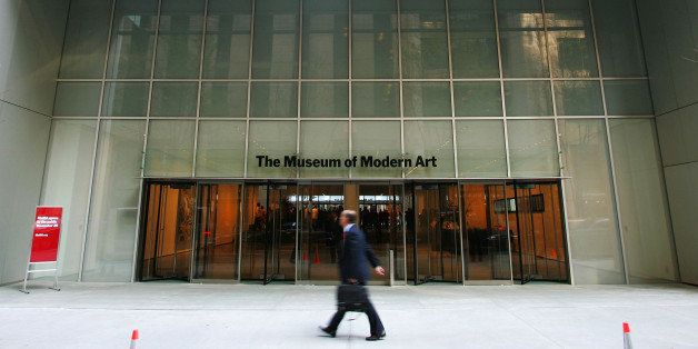 NEW YORK - NOVEMBER 17:  A pedestrian walks outside the entrance to the new Museum of Modern Art building on 53rd Street Nove