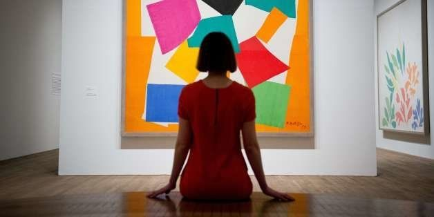 A gallery assistant in front of 'L'Escargot' by French artist Henri Matisse at the 'Henri Matisse: The Cut-Outs' exhibition a