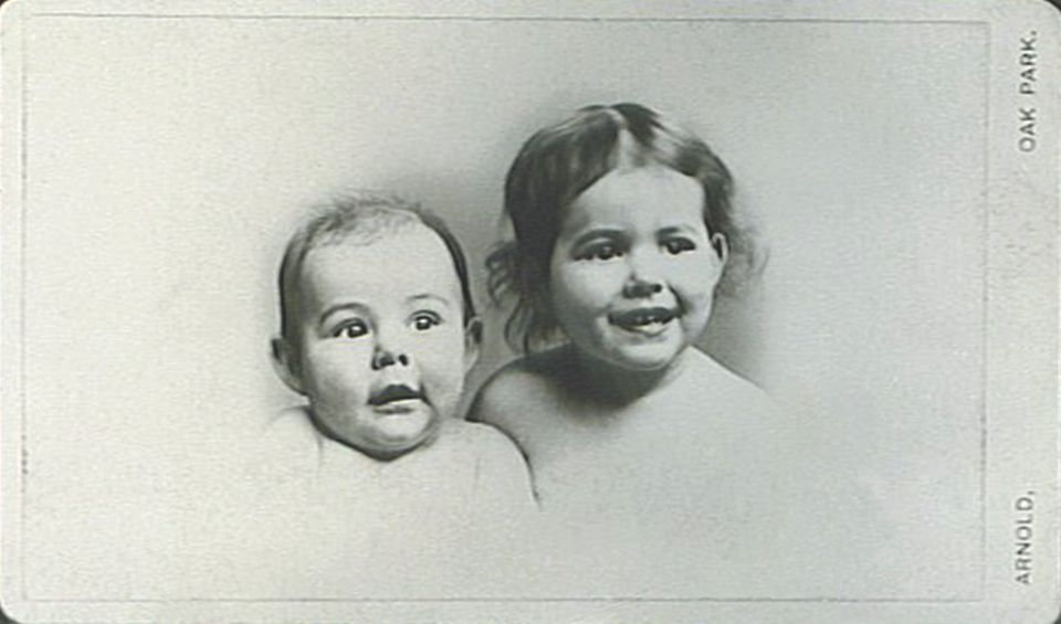 Ernest Hemingway at six months with his sister Marcelline, age two.